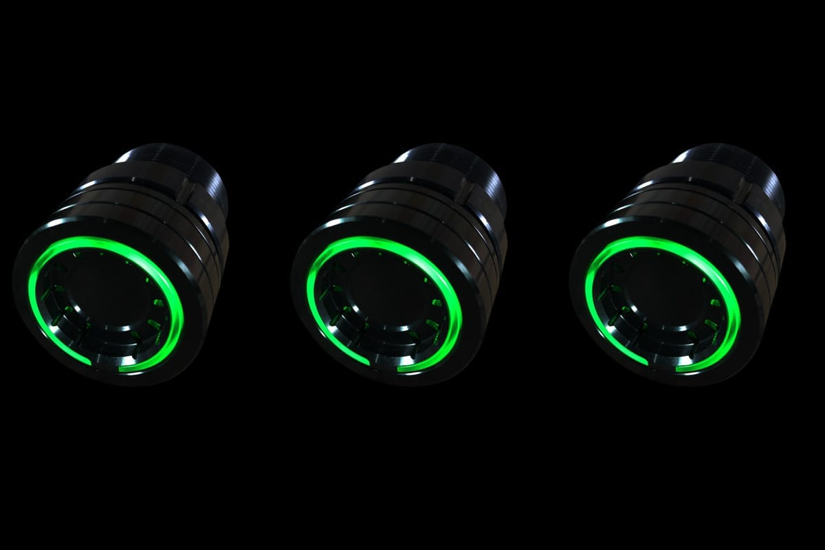 PODS GREEN LIGHT SYNISTER BLACK BLACK BACKGROUND LEFT DOWN